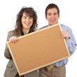 Holding the empty corkboard — Stock Photo