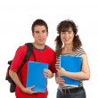 Two students with books and backpacks — Stock Photo