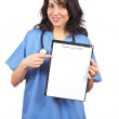 Female doctor showing a blank clipboard — Stock Photo