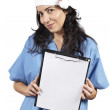 Female doctor holding the clipboard — Stock Photo
