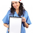 Female doctor holding the clipboard — Stock Photo #5881134