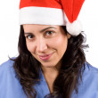 Female doctor with christmas hat — Stock Photo #5881139