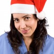 Female doctor with christmas hat — Stock Photo