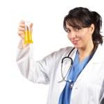 Female doctor examining test flasks — Stock Photo