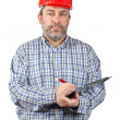 Construction worker writing - Stock Photo