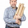 Construction worker holding cardboard tubes — Stock Photo
