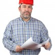 Stock Photo: Construction worker holding blueprints
