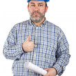 Construction worker holding blueprints — Stock Photo