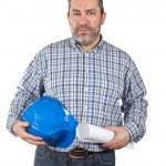 Construction worker holding blueprints — Stock Photo