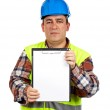 Construction worker showing a blank notebook — Stock Photo