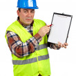 Construction worker showing a blank notebook — Stock Photo #5881446