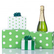 Gifts and champagne bottle — Stock Photo