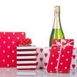 Gifts and champagne bottle - Stock Photo