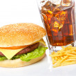 Cheeseburger, soda and french fries — Stock Photo