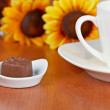Coffee with chocolate candies — Stock Photo