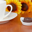 Coffee with chocolate candies — Stock Photo #5882278