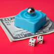 Dices and marble steel over blue platform and ten dollar bill, on a red bac — Stock Photo #5882506