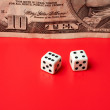 Ten dollar and dices, on a red background — Stock Photo