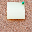 Stock Photo: Yellow postit on corkboard