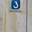 Number three on a wall - Stock Photo