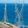 Two High voltage towers - Stock Photo