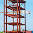 Steel Structure and Construction crane set against a blue sky — Stock Photo #5882656