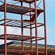 Steel Structure and Construction crane set against a blue sky — Stock Photo