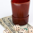 Dices and leather thrower with money - Stock Photo