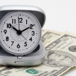 Clock and money (dollars) — Stock Photo