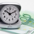 Clock and money (euros) — Stock Photo