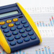 Calculator on earnings chart — Stockfoto #5882947