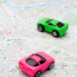 Two cars on the map - Stock Photo
