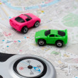 Compass and two cars, on the map - Stock Photo