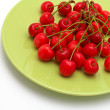 Cherries on the green plate — Stock Photo
