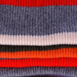 Several colors pullovers stack — Stock Photo