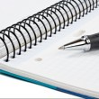 Foto de Stock  : Detail of pen and blank notebook sheet