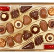 Stock Photo: Chocolates in a box