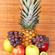 Fresh fruits on bamboo mat — Stock Photo
