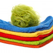 Multicolour towels stacked and body sponge — Stock Photo #5883730