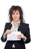 Put dollars bills on the envelope — Stock Photo