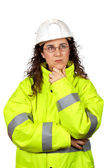 Worried female construction worker — Stock Photo