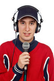 Disc jockey with headphones and microphone — Stock Photo