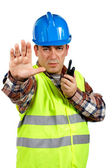 Construction worker talking with a walkie talkie and orders to s — Stock Photo