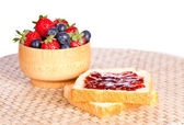 Two toast with jam, blueberries and strawberries — Stok fotoğraf