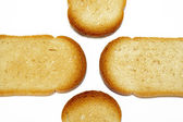 Slices of toasted bread background — Stock Photo