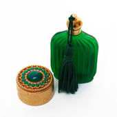 Antique gold box and green bottle — Stock Photo