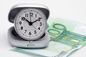 Clock and money (euros) — Stock Photo