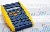 Calculator on earnings chart — Stock Photo