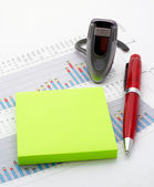 Handsfree, notes and pen on earnings chart background — Stock Photo