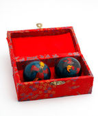 Chinese balls inside the red box — Stock Photo